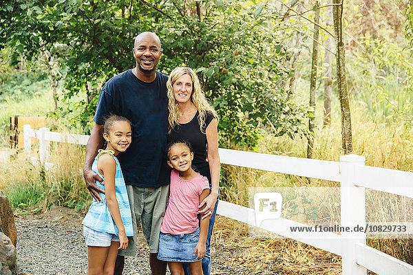 Family smiling on gravel path