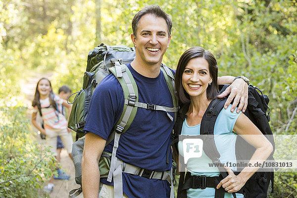 Caucasian family hiking on path