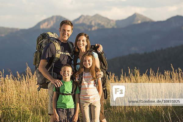 Caucasian family smiling in remote landscape