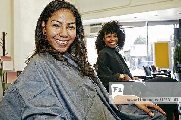 Customers smiling in salon