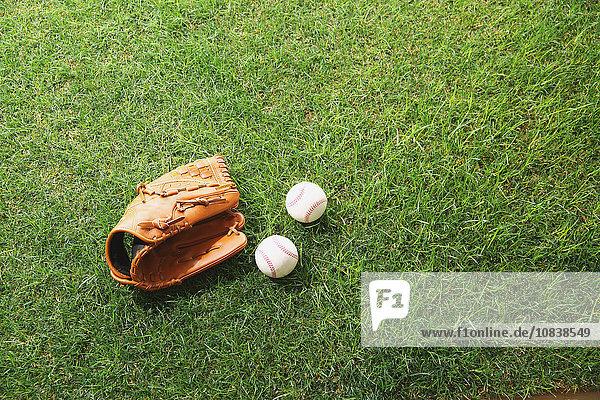 Baseball equipment on grass