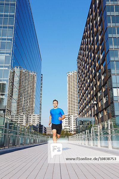 Young Caucasian man running in metropolitan area