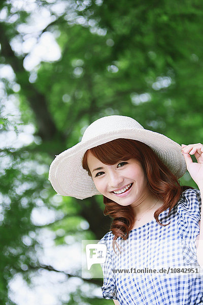 Young attractive Japanese woman in a city park