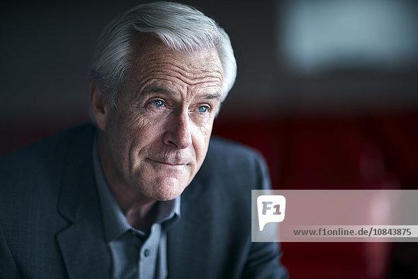 Pensive senior businessman looking away