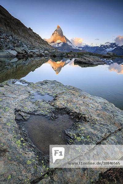 The Matterhorn reflected in Lake Stellisee at dawn  Zermatt  Pennine Alps  Canton of Valais  Swiss Alsp  Switzerland  Europe