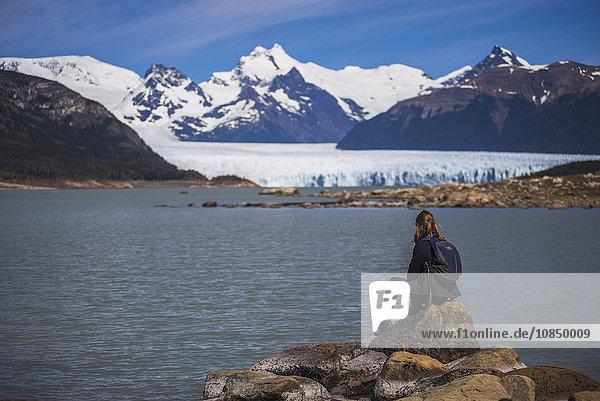 Woman at Perito Moreno Glaciar  Los Glaciares National Park  UNESCO World Heritage Site  near El Calafate  Patagonia  Argentina  South America