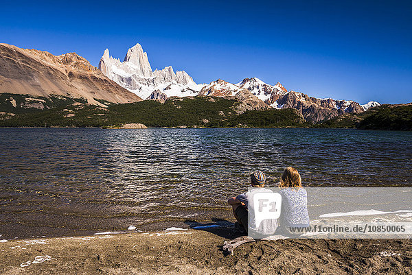 Tourists at Lago Capri (Capri Lake) with Mount Fitz Roy (Cerro Chalten) behind  El Chalten  Patagonia  Argentina  South America