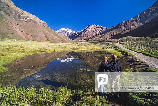 Trekking in Aconcagua Provincial Park with 6961m peak of Aconcagua behind  Andes  Mendoza Province  Argentina  South America