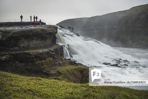Tourists at Gullfoss Waterfall in the canyon of the Hvita River  The Golden Circle  Iceland  Polar Regions
