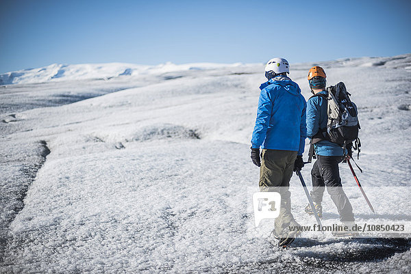 Tourists walking on Breidamerkurjokull Glacier  Vatnajokull Ice Cap  Iceland  Polar Regions