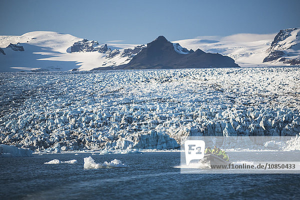 Zodiac boat tour on Jokulsarlon Glacier Lagoon  with Breidamerkurjokull Glacier and Vatnajokull Ice Cap behind  South East Iceland  Iceland  Polar Regions