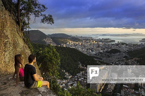 Hikers looking out over Rio from the Morro dos Cabritos  Rio de Janeiro  Brazil  South America