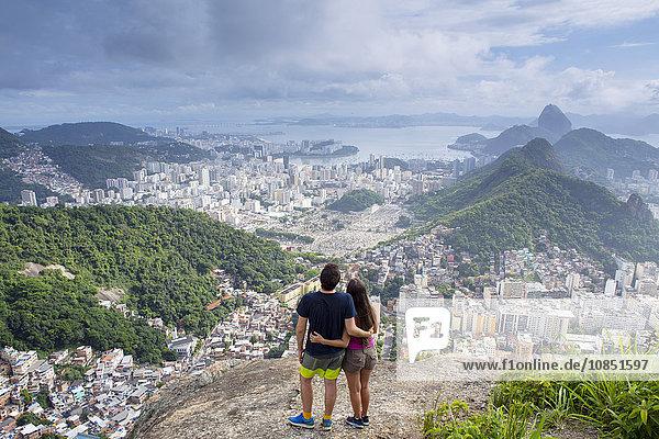 Hikers looking out over Rio de Janeiro from the Morro dos Cabritos hill  Rio de Janeiro  Brazil  South America