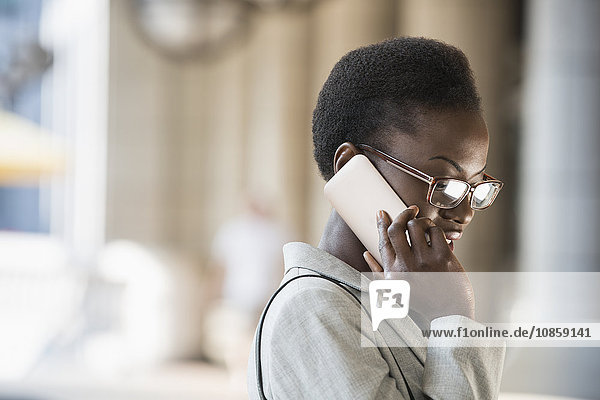 Corporate businesswoman talking on cell phone