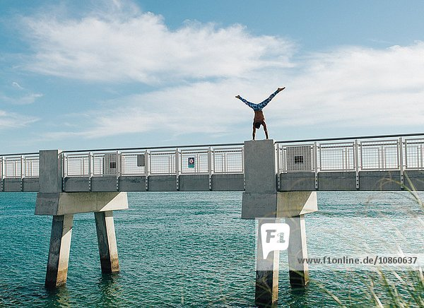 Man doing handstand on bridge  South Pointe Park  South Beach  Miami  Florida  USA