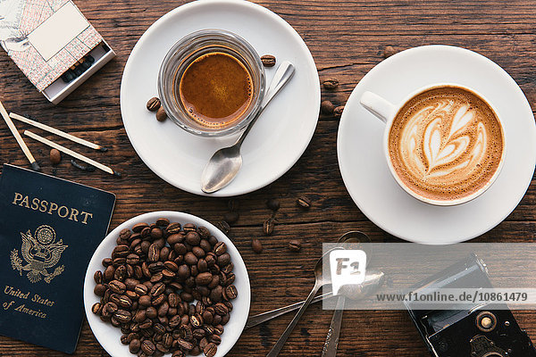 Overhead view of coffee's  coffee beans and American passport on coffee shop table