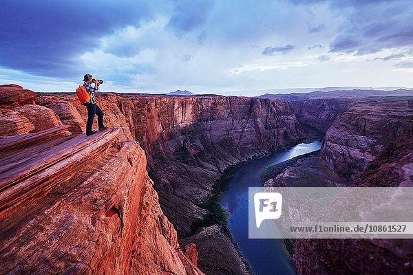 Photographer taking picture  Colorado River  Arizona