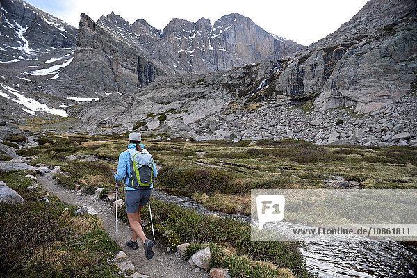 Hiker exploring Chasm Lake  Rocky Mountains National Park  Colorado