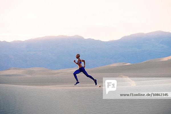 Runner sprinting in desert  Death Valley  California  USA