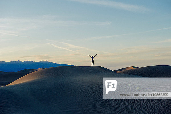Person stretching arms at sunset  Death Valley  California  USA