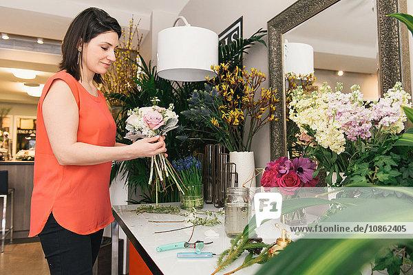 Florist arranging bouquet in flower shop