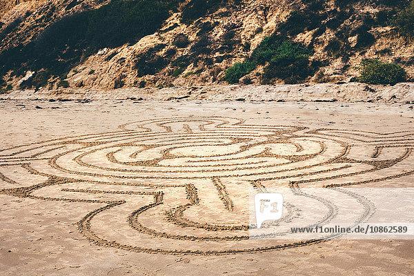 Line drawing pattern drawn onto beach sand  Crystal Cove State Park  Laguna Beach  California  USA