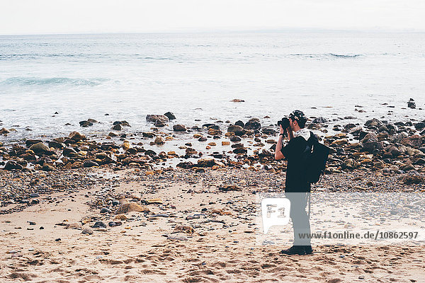 Male photographer photographing from beach  Crystal Cove State Park  Laguna Beach  California  USA