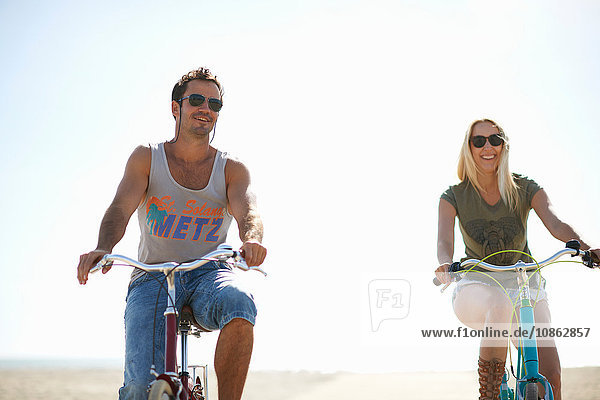 Cycling couple cycling on Venice Beach  Los Angeles  California  USA