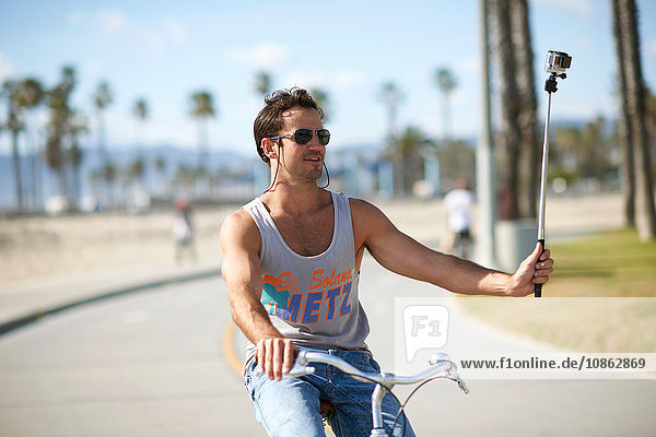 Male cyclist taking cycling selfie at Venice Beach  Los Angeles  California  USA