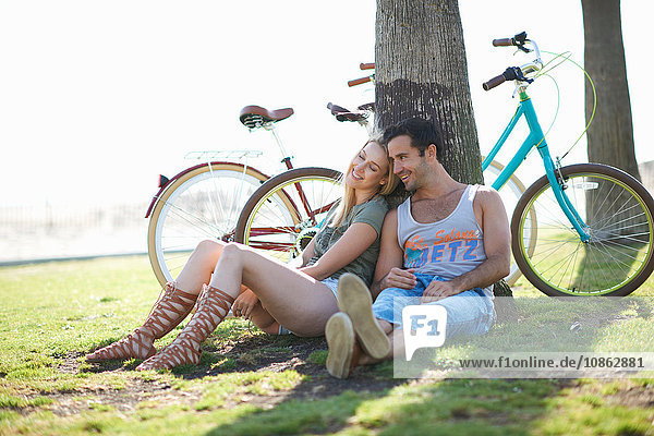 Cycling couple taking a break at Venice Beach  Los Angeles  California  USA