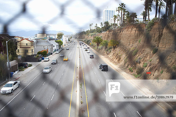 View through fence onto highway  Los Angeles  USA