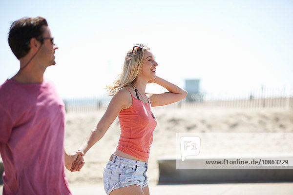 Couple outdoors  holding hands