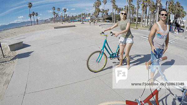 Portrait of cycling couple at Venice Beach  California  USA