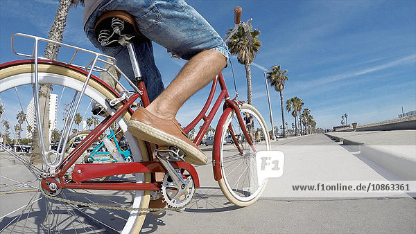 Cropped view of couple cycling at Venice Beach  California  USA