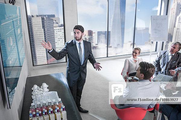 Businessman pointing at screen at presentation  New York  USA