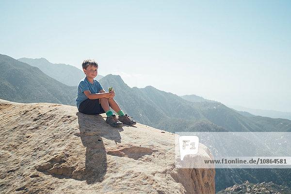 Portrait of boy sitting on boulder  Santa Barbara  California  USA