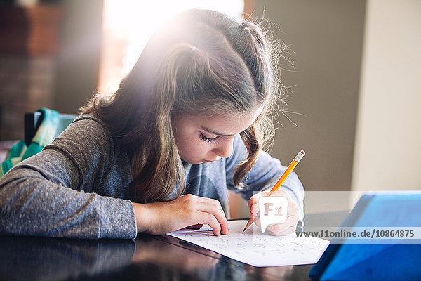 Girl at desk writing