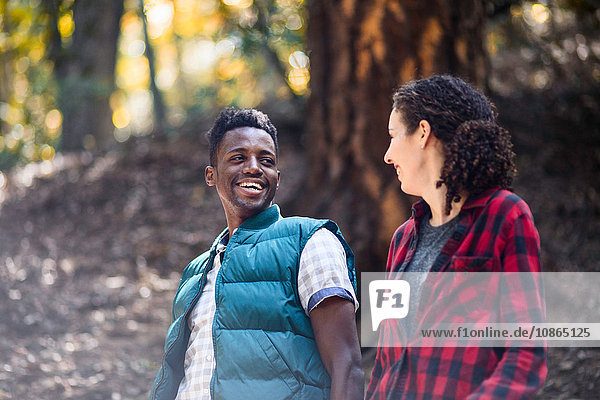 Romantic young hiking couple hiking in forest  Arcadia  California  USA