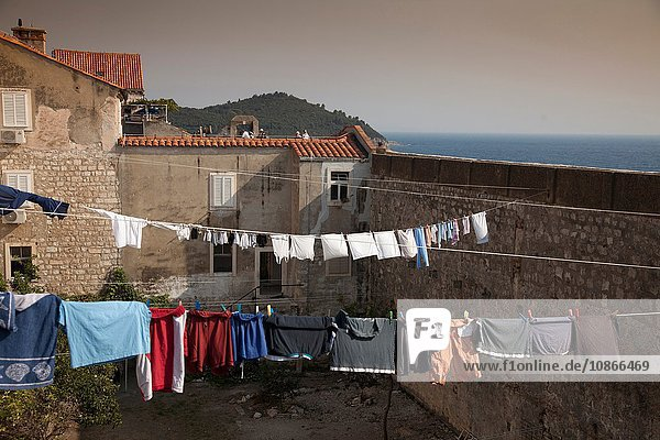 Clothes hanging from lines on rooftops