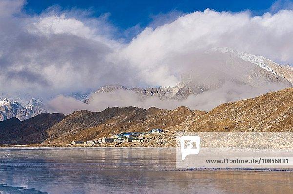 Mountains and village on rural lake