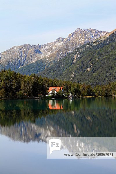 Mountains reflected in still rural lake