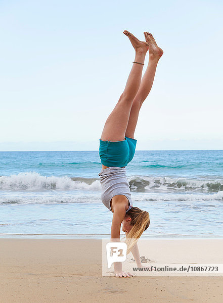 Young woman doing handstand on beach  Dominican Republic  The Caribbean