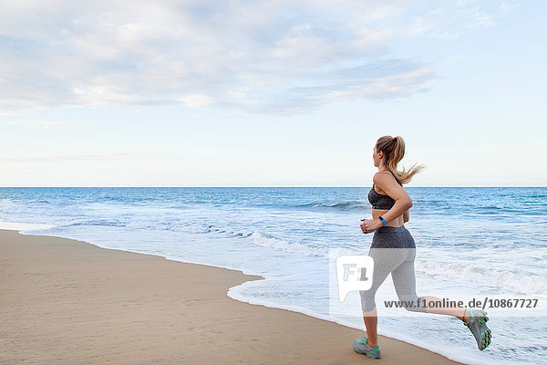 Young female runner running on beach  Dominican Republic  The Caribbean