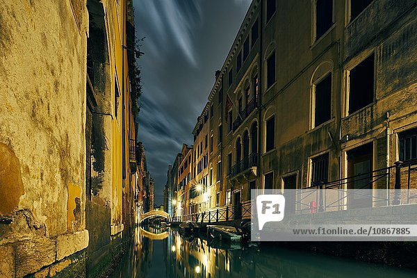 Canal and traditional waterfront houses at night  Venice  Italy