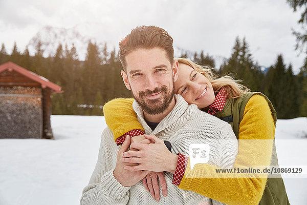Portrait of romantic couple in snow  Elmau  Bavaria  Germany