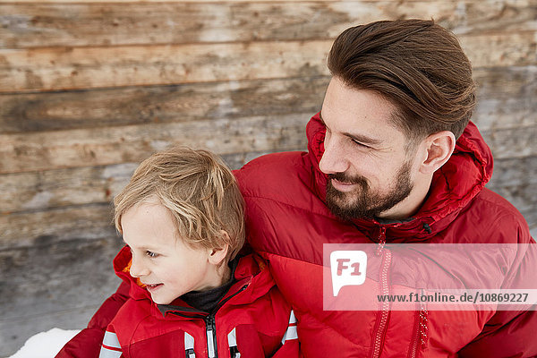 Young man and son at cabin in snow  Elmau  Bavaria  Germany