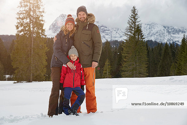 Portrait of parents and son in snow covered landscape  Elmau  Bavaria  Germany