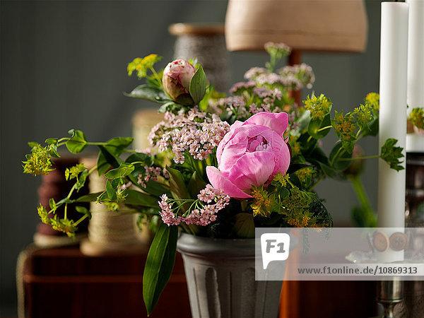 Flower arrangement in front of traditional bobbins