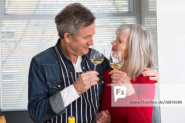 Couple toasting in kitchen