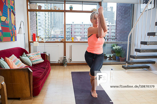 Woman practising yoga at home